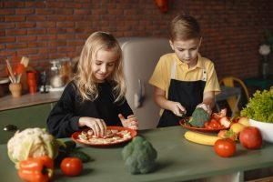 Canva Children Slicing Vegetables