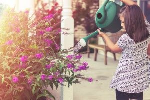 Canva Girl Watering Flowers